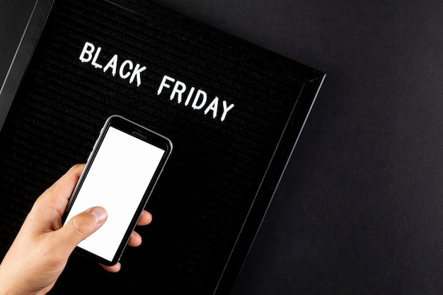 Phone mock up next to a black friday sign