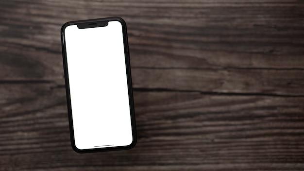 Телефон на деревянных фоне с белым экраном для копирования пространство.