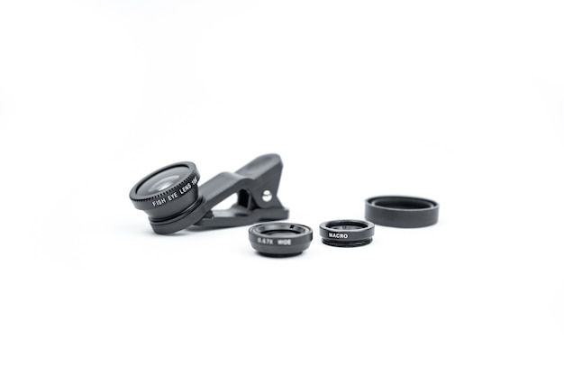 Phone photo lens with clips on white surface. extra macro camera for smartphone. set of lenses wide angle, fish eye and macro