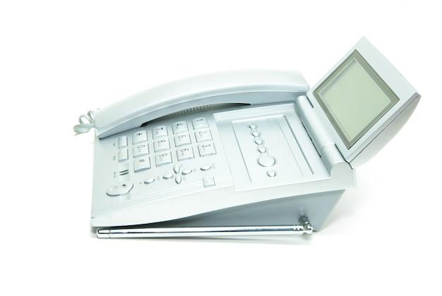 흰색 배경에 케이블이 있는 전화