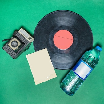 Phonograph gramophone disk with a water bottle top view