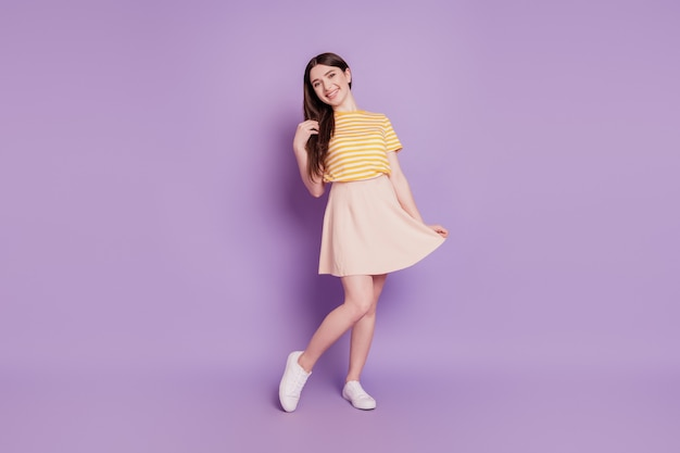 Photo of adorable dreamy inspired cute girl touch hairstyle look camera on purple background