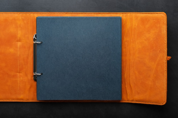 Photo album with empty space for photos, white frames on black paper.