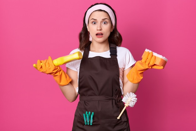 Photo of amazed woman, does household duties