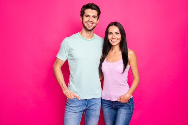 Photo of amazing couple guy and lady standing hugging enjoy best company wear casual clothes isolated bright pink color background