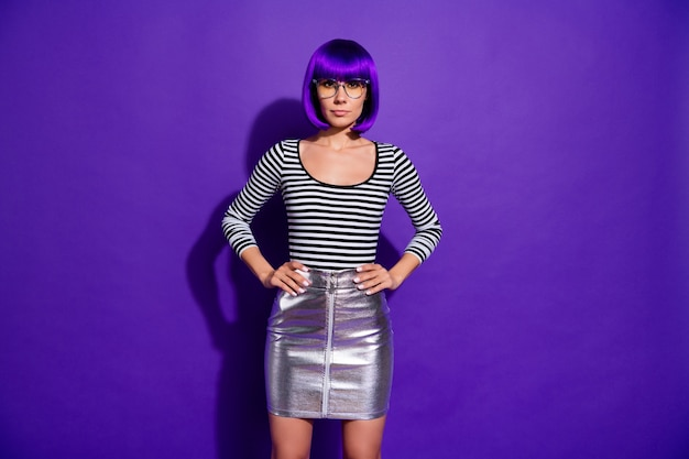 Photo of amazing exotic appearance lady wear specs silver skirt striped pullover isolated vivid purple background