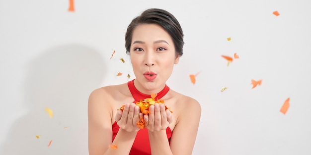 Photo of amazing lady blowing shiny confetti making fairy tale wear red dress isolated white background