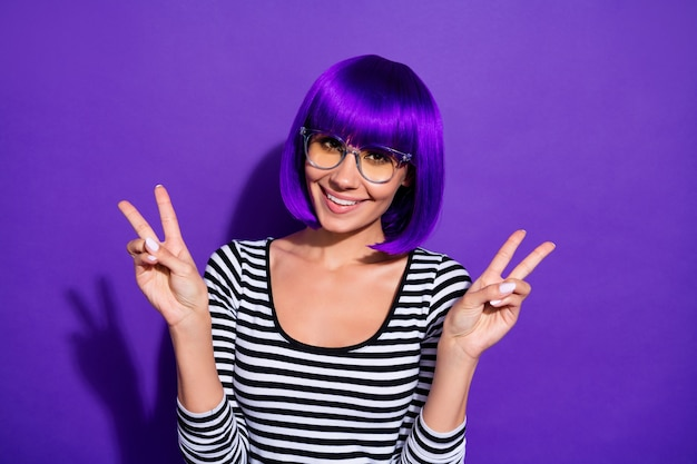 Photo of amazing lady hands showing v-sign symbol wear specs striped pullover isolated purple background