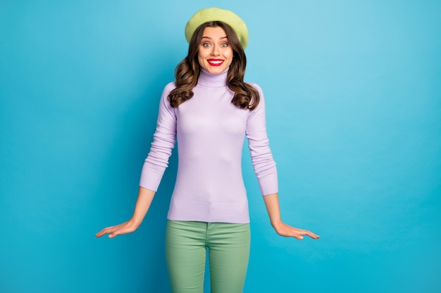 Photo of amazing traveler lady beaming smiling stylish look good mood wear modern green beret hat purple turtleneck jumper pants isolated blue color wall