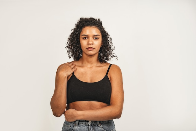 Photo of attractive black woman, wears black top. isolated over white background.