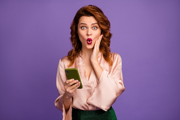Photo of attractive crazy lady hold telephone open mouth arm cheek
