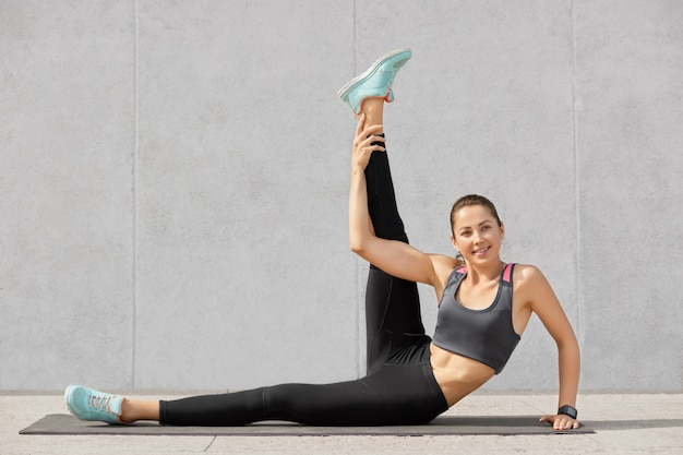 Photo of attractive woman does abdominal exercises