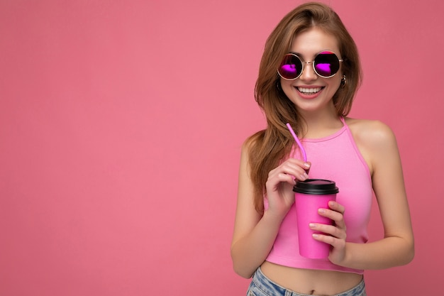 Photo of attractive young happy smiling blonde woman wearing everyday stylish clothes