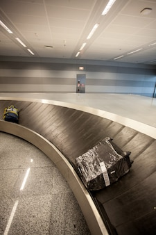 Photo of baggage claim line in airport terminal