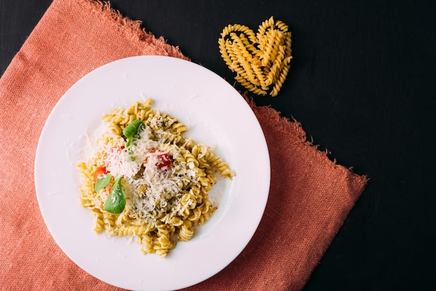 Photo of beautiful and tasty pasta made with love, heart from pasta