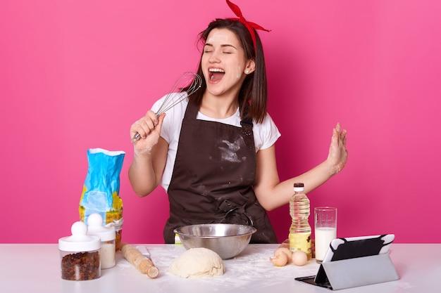 Photo of beautiful woman making cake.