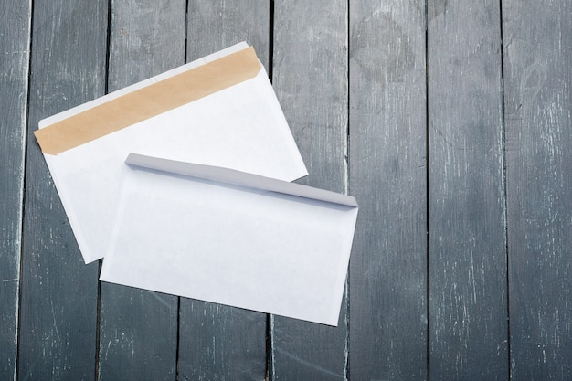 Photo of blank envelope on a wood