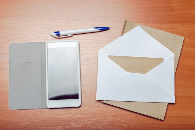 Photo of blank envelope on a  wooden surface