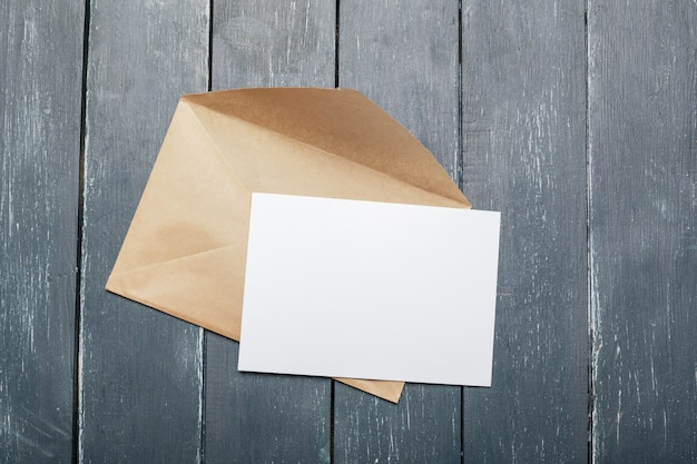 Photo of blank envelope on a  wooden