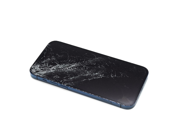 Photo of blue smartphone with broken damaged display. modern smartphone with damaged glass screen on white surface. device needs repair.