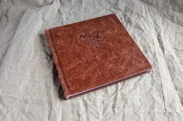 Photo book with a cover of genuine leather.