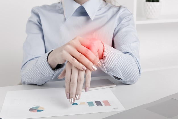 Photo of businesswoman in office with skin problems.