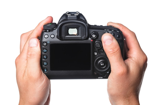 흰색 배경에 고립 된 손에 사진 카메라