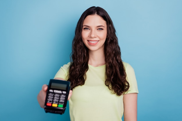 Photo of charming adviser business lady look camera demonstrate new terminal device on blue background