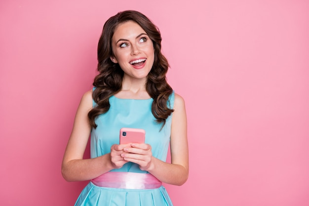 Photo of charming cheerful lady festive clothes event hold telephone hands texting friends