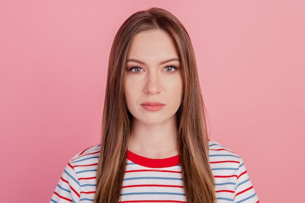 Photo of charming goregous lady calm face look camera posing on pink background