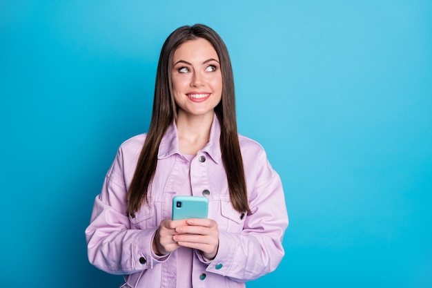 Photo of charming lady hold telephone hands browsing smart phone addicted user