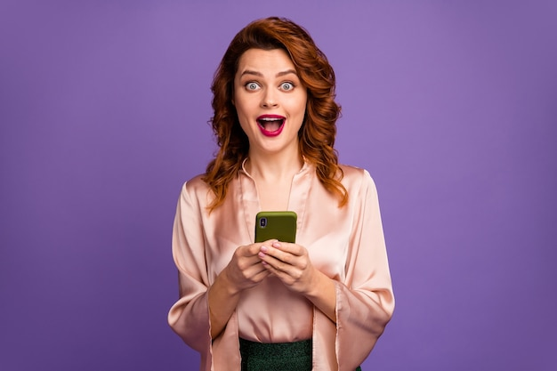 Photo of charming pretty lady hold telephone crazy face