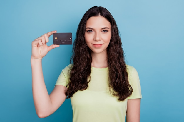 Photo of charming sweet gorgeous adviser girl hold credit card on blue background
