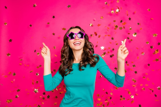 Photo of cheerful positive curly wavy nice pretty cute charming millennial wearing spectacles star shaped smiling toothily isolated vibrant color fuchsia background