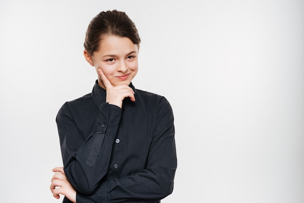 Photo of cheerful young girl posing isolated