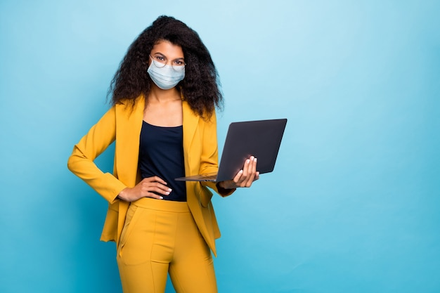 Photo of classy lady using laptop wearing safety mask preventive measures working remotely from home