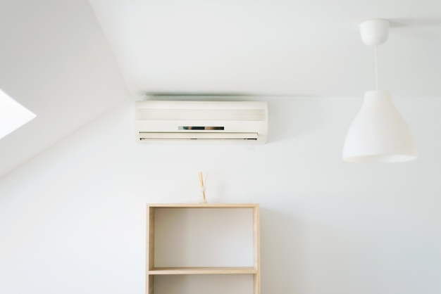 Photo of clean white room with air condition, summer days can be coolest.