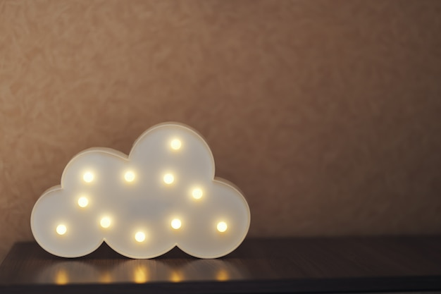 Photo of a cloud shaped lamp turned on and shining