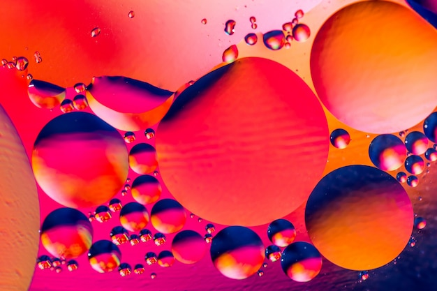 Photo of colorful bubbles of oxygen in water.