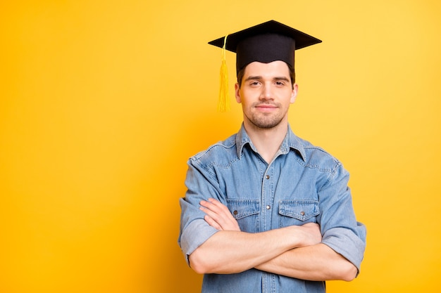Photo of confident serious worker having graduated able to do all assignments required with hands folded isolated vivid color wall