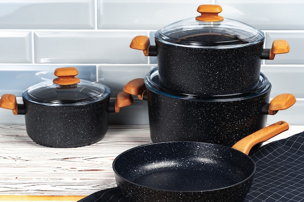 Photo of cookware set on wooden kitchen counter
