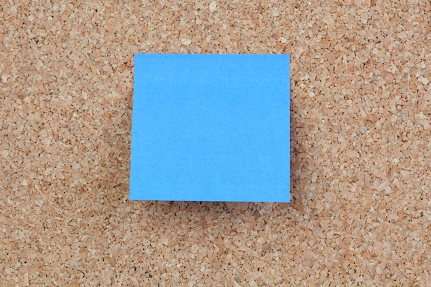 Photo of corkboard with a blue post-it