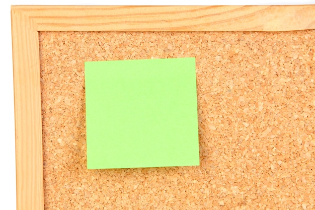 Photo of corkboard with a green post-it