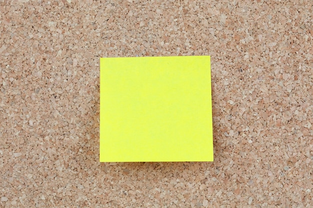 Photo of corkboard with a yellow post-it