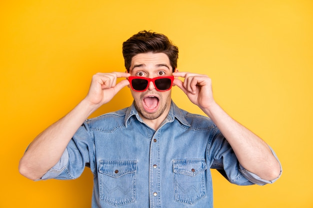 Photo of crazy stupor man wearing red sunglass shocked about sales in eye wear isolated vivid color wall