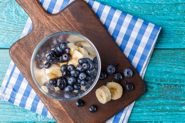 Photo of cup of blueberries and chopped banana