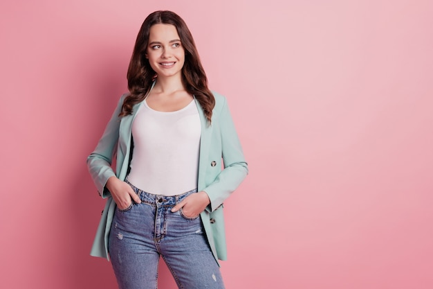Photo of curious dreamy lady in fashionable outfit cunning look empty space on pink background