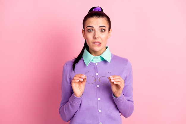 Photo of cute girl take off hold specs horrified look camera wear violet cardigan isolated pink color background