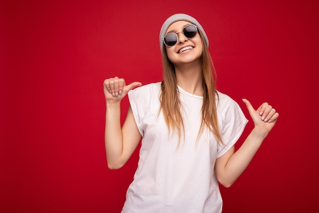 Photo of cute nice winsome positive adult woman wearing casual outfit isolated on background wall