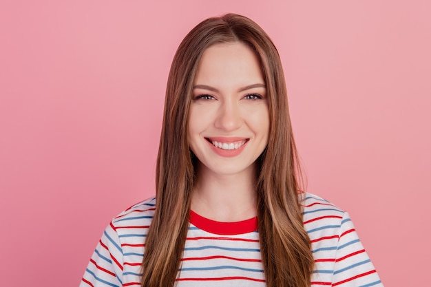 Photo of dreamy lovely pretty lady beaming shiny smile on pink background